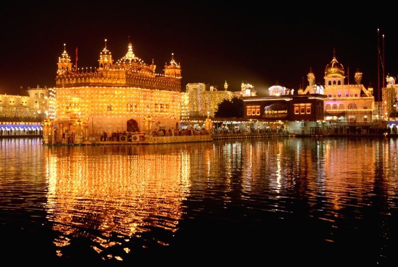 A view of the Illuminated Golden Temple on the eve of Diwali, in Amritsar.