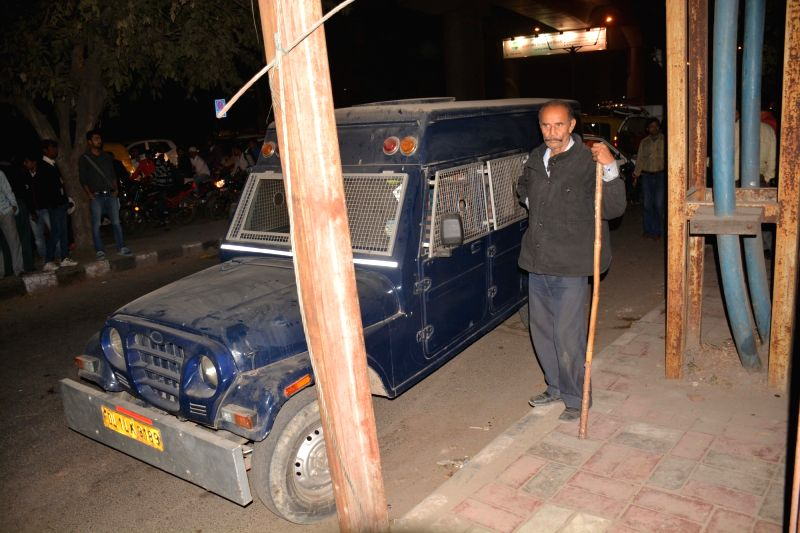 A view of the van whose driver fled with Rs.22.5 crore after halting it near Govindpuri metro station, in New Delhi on Nov 26, 2015.