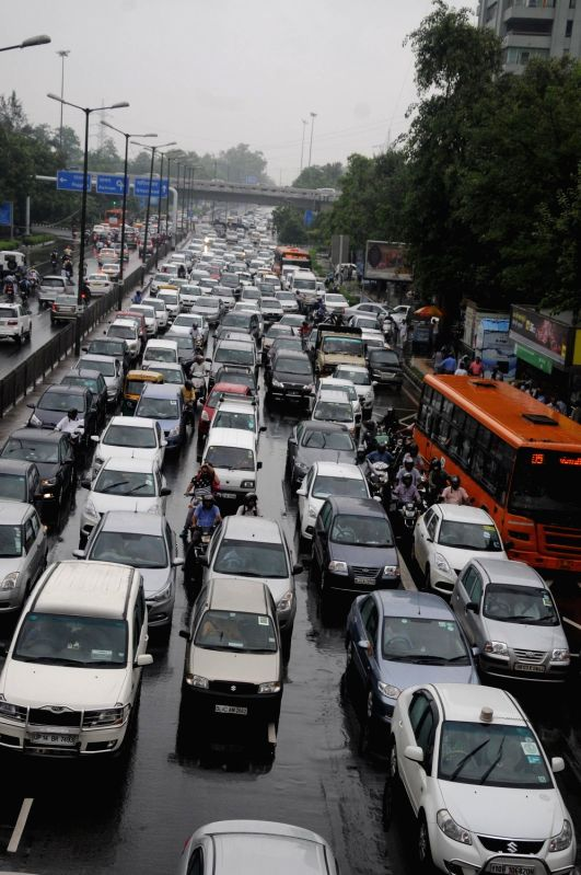 A view of traffic jam due to heavy downpour in New Delhi on July 27, 2016.