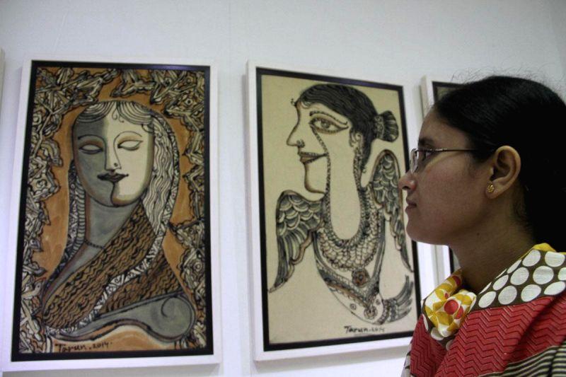 A visitor at a pen art exhibition organised at Manobhumi Art Gallery of Dhaka,Bangladesh Dhaka, Bangladesh on Aug 29, 2014.