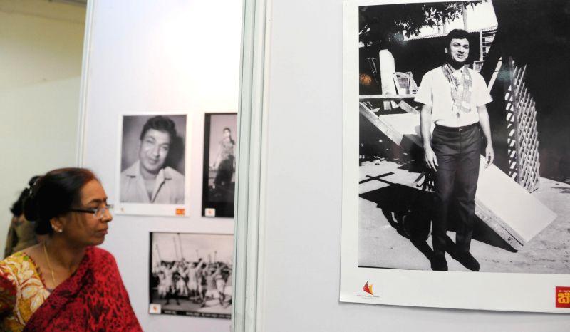 A visitor at a photo exhibition exhibiting rare photographs of Dr Rajkumar at Chitrakala Parishath in Bangalore on June 22, 2014.