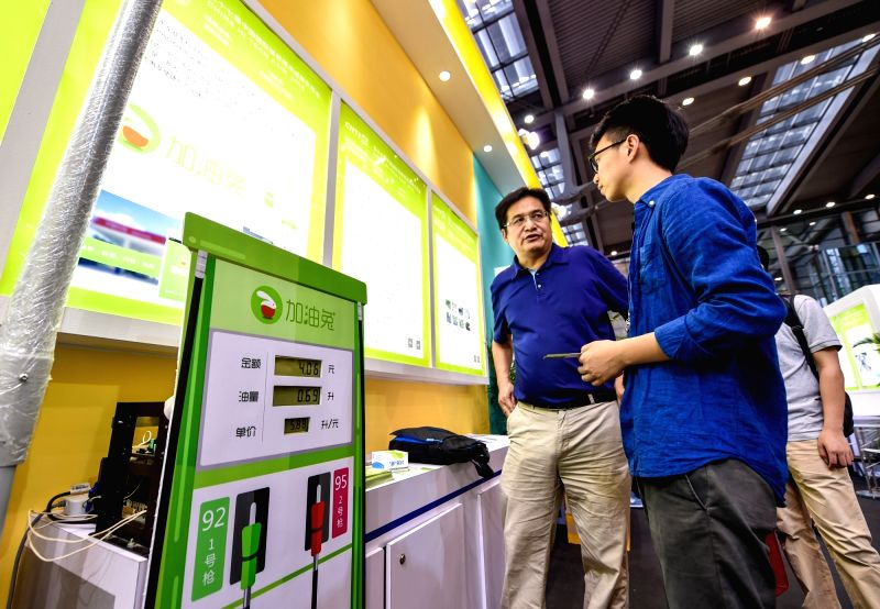 A visitor listens to introduction while visiting the 17th China Hi-tech Fair in Shenzhen, south China's Guangdong Province, Nov. 17, 2015. (Xinhua/Mao Siqian) ...