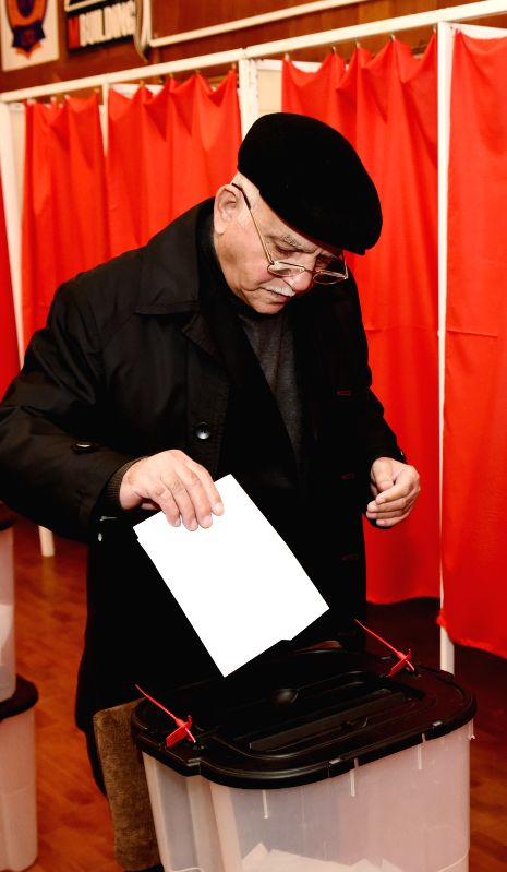 A voter casts his ballot at a polling station in Baku, Azerbaijan, Nov. 1, 2015. Azerbaijan held its 5th parliamentary elections early Sunday to pick the 125 deputies ...