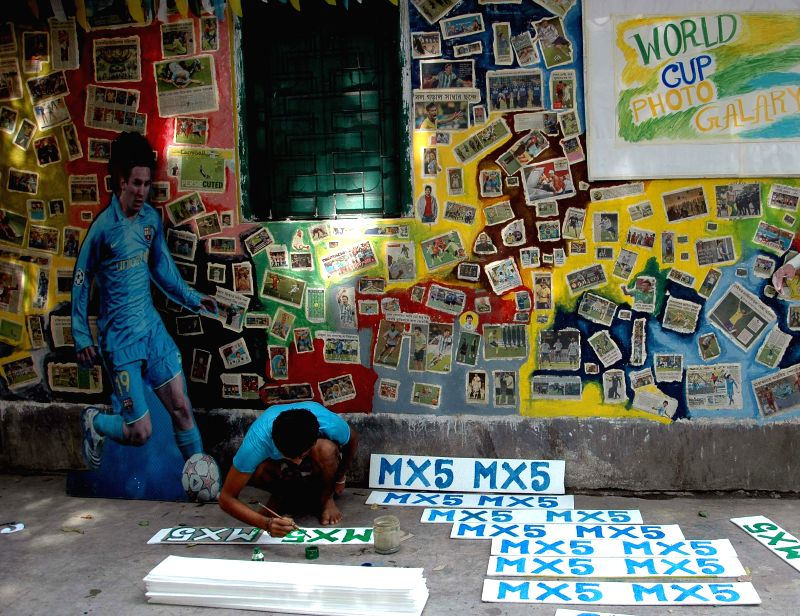 A wall being decorated with World Cup 2014 photos in Kolkata on July 5, 2014.