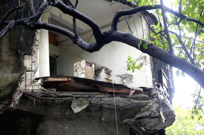 A wall collapses in Sewri of Mumbai due to heavy rains on July 12, 2014.