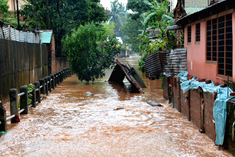 A wall that collapsed in heavy rains in Guwahati on June 27, 2014.