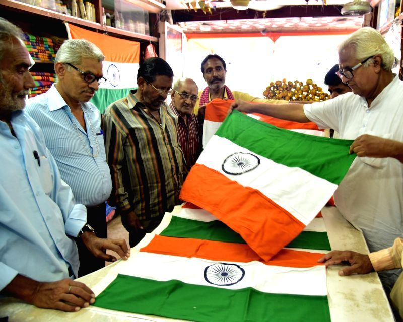 A woker display Indian flags at Khadi Gram Udyog ahead of Independence Day in Bikaner on Aug 10, 2016.