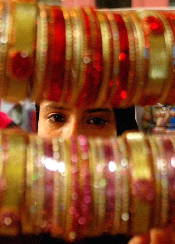 A woman at a bangle shop ahead of Eid-ul-Fitr in Kolkata on July 23, 2014.