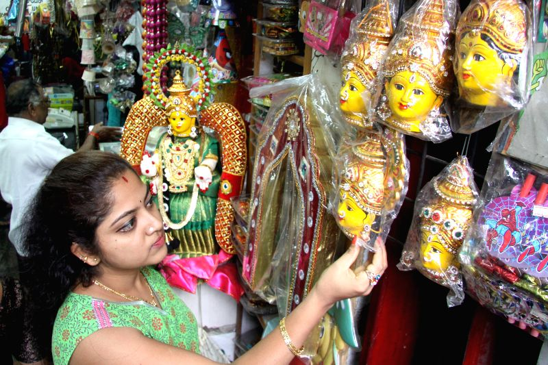 A woman busy shopping ahead of Varamahalakshmi festival in Bangalore on Aug 6, 2014.