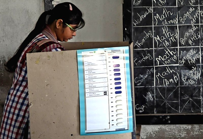 A woman casts her vote at a polling booth during the seventh phase of 2014 Lok Sabha Polls in Sreerampur of West Bengal on April 30, 2014.