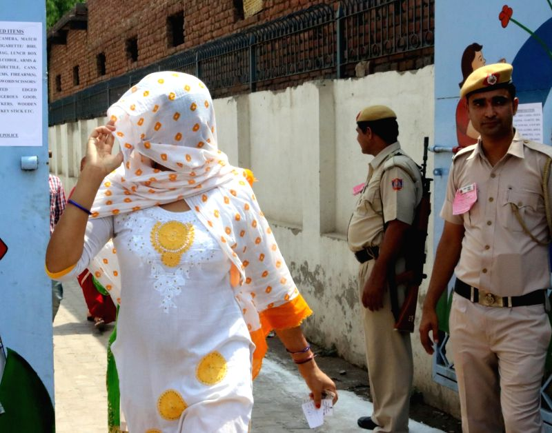 A woman comes out after casting her vote during Municipal Corporation of Delhi (MCD) Polls in New Delhi, on May 15, 2016.