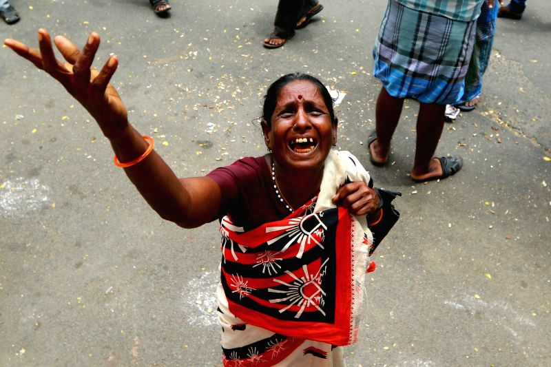 A woman outside the Kauvery Hospital where Karunanidhi is admitted, in Chennai, on Aug 7, 2018.