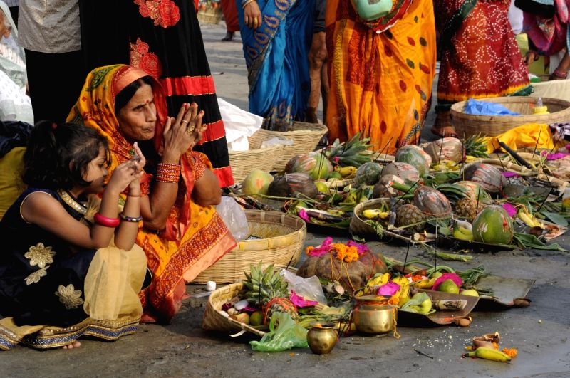 A woman perform rituals on Chhath puja in Patna