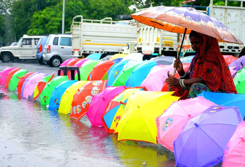 A woman sells umbrellas during rains in Jaipur on July 9, 2015.