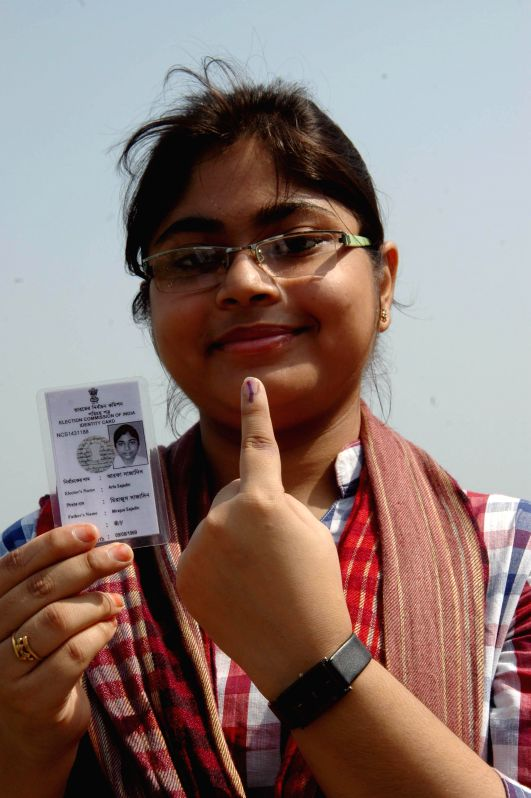 A woman shows her fore finger marked with phosphorous ink after casting her vote at a polling booth during the seventh phase of 2014 Lok Sabha Polls in Sreerampur of West Bengal on April 30, 2014.
