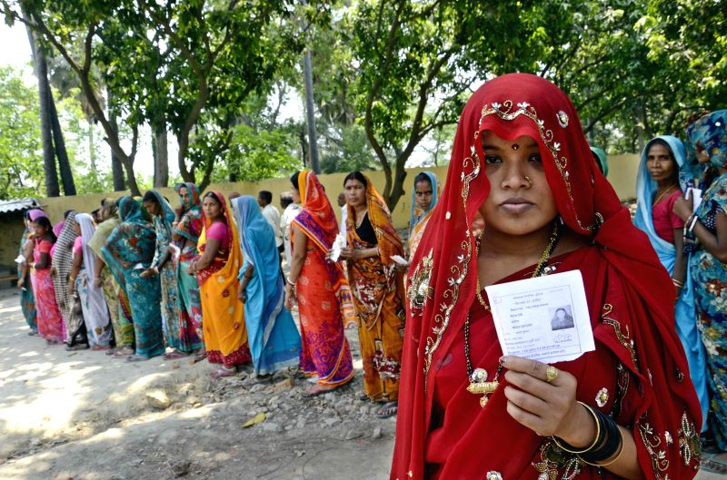 A woman shows her voter's identity card after casting her vote during the eighth phase of 2014 Lok Sabha elections in Hajipur of Bihar on May 7, 2014.