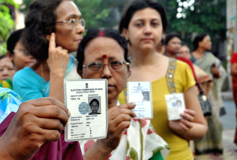 A woman shows her voters' identity card at a polling booth during the ninth phase of 2014 Lok Sabha Polls in Kolkata on May 12, 2014.