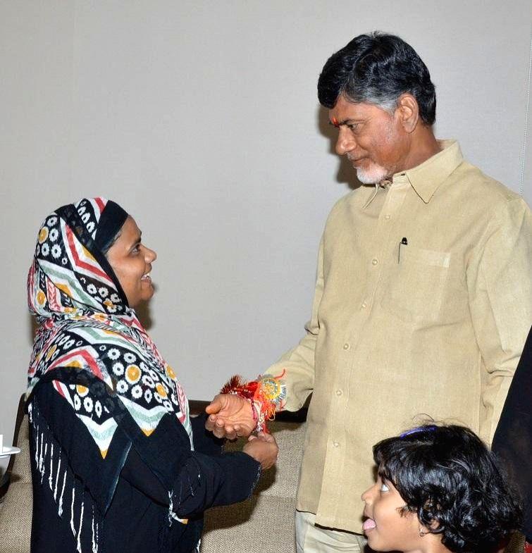 A woman ties a `rakhi` on the wrist of Andhra Pradesh Chief Minister N. Chandrababu Naidu on Raksha Bandhan in Hyderabad on Aug 10, 2014. - N. Chandrababu Naidu