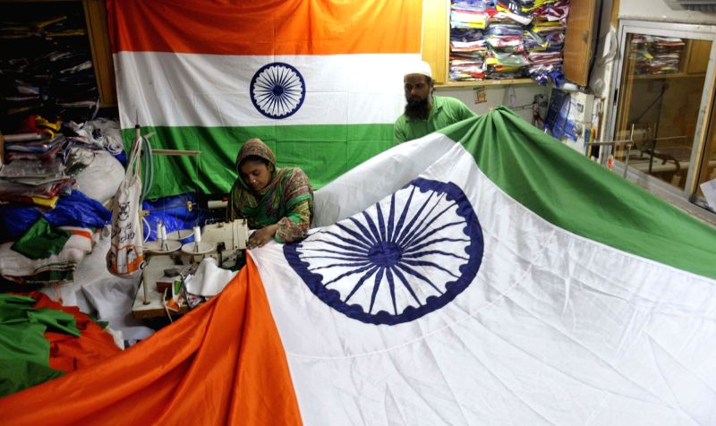 A worker busy stitching a tricolor ahead of Independence Day celebrations, at a workshop in Mumbai on Aug 8, 2018.