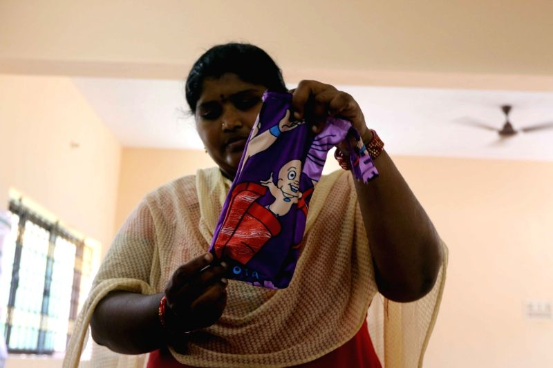 A worker shows a stitched biodegradable water bottle cover ahead of a plastic ban announced by the Tamil Nadu government, in Chennai on July 16, 2018. The state government recently issued ...