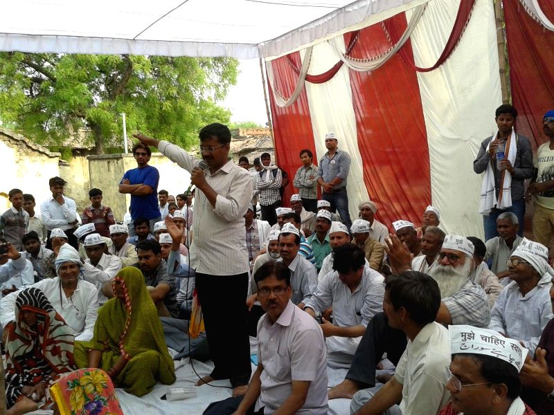 Aam Aadmi Party (AAP) leader Arvind Kejriwal addresses during a meeting at a village near Varanasi on April 17, 2014.