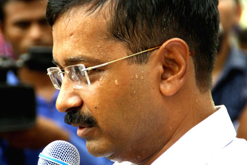Aam Aadmi Party (AAP) leader Arvind Kejriwal addresses during a sit-in demonstration organised by `All Guest Teachers Association Delhi`in New Delhi on July 12, 2014.