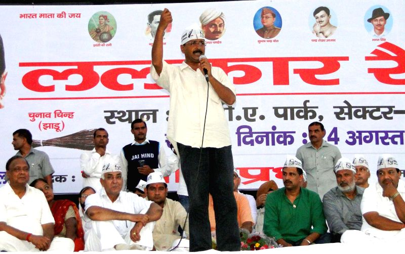 Aam Aadmi Party (AAP) leader Arvind Kejriwal addresses a rally at Rohini in New Delhi on Aug 24, 2014. - Arvind Kejriwal