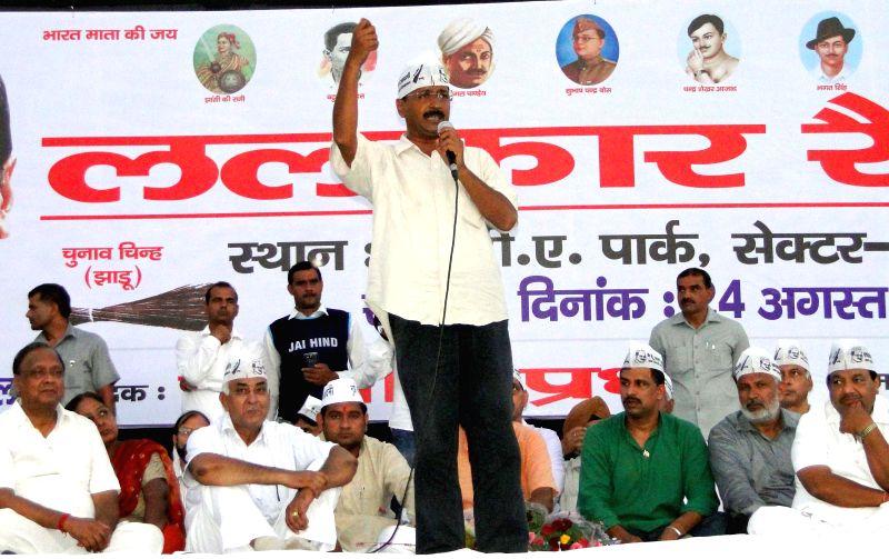 Aam Aadmi Party (AAP) leader Arvind Kejriwal addresses a rally at Rohini in New Delhi on Aug 24, 2014. - Arvind Kejriwal