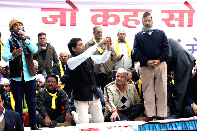 Aam Aadmi Party (AAP) leader Arvind Kejriwal addresses during a meeting with traders of Delhi in New Delhi, on Dec 29, 2014.