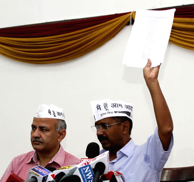 Aam Aadmi Party (AAP) leader Arvind Kejriwal and party aide Manish Sisodia address a press conference in New Delhi on Aug 22, 2014. - Arvind Kejriwal