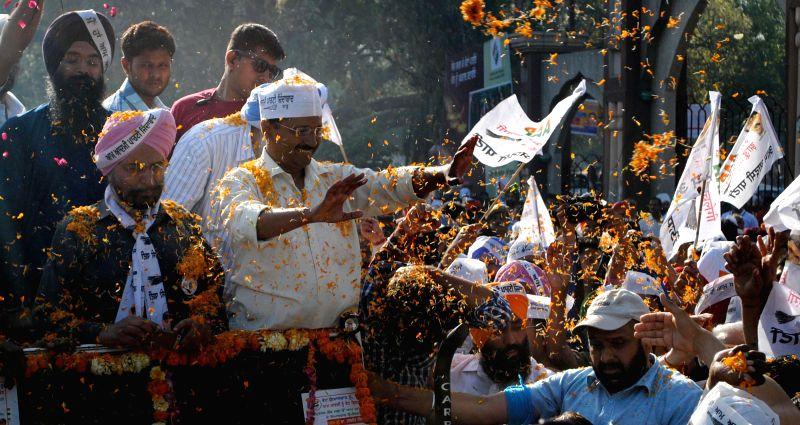 Aam Aadmi Party (AAP) leader Arvind Kejriwal during a roadshow in Amritsar on April 11, 2014. - Arvind Kejriwal