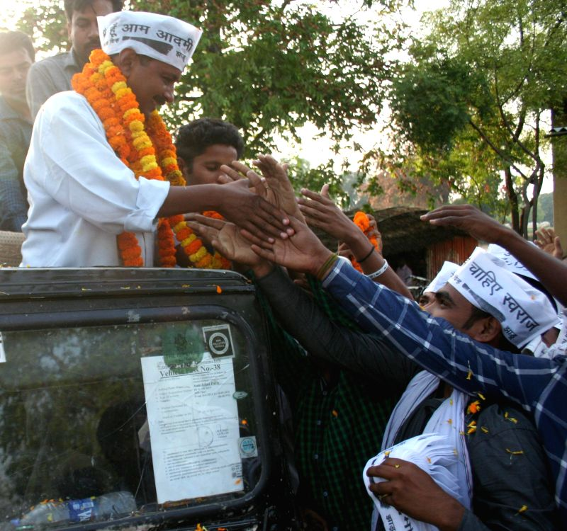 Aam Aadmi Party (AAP) leader Arvind Kejriwal during a road show in rural areas of Varanasi on May 6, 2014. - Arvind Kejriwal