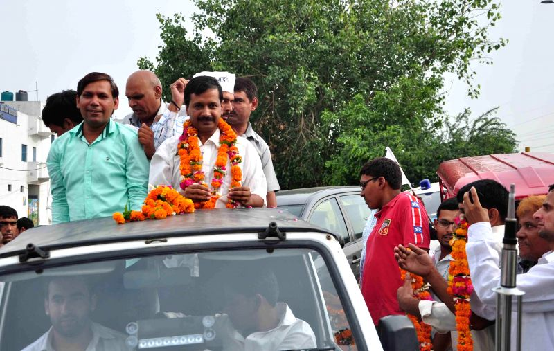 Aam Aadmi Party (AAP) leader Arvind Kejriwal during a road show at Bhajanpura in North East Delhi on July 2, 2014. - Arvind Kejriwal