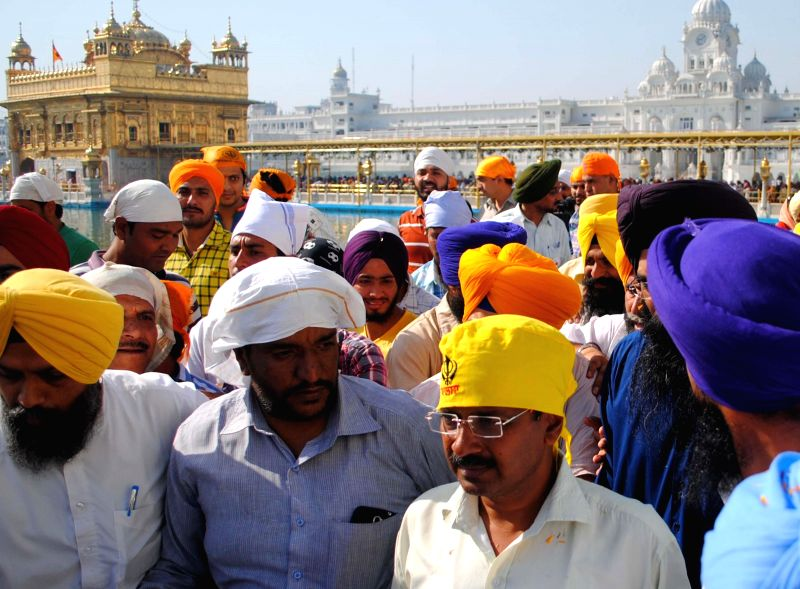 Aam Aadmi Party (AAP) leader Arvind Kejriwal pays obeisance at the Golden Temple in Amritsar on April 11, 2014.
