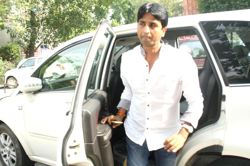 Aam Aadmi Party (AAP) leader Kumar Vishwas arrives to attend party legislators' meeting at Constitution club in New Delhi on June 18, 2014.