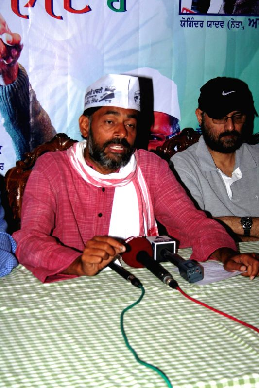 Aam Aadmi Party (AAP) leader Yogendra Yadav addresses a press conference in Amritsar on April 27, 2014.