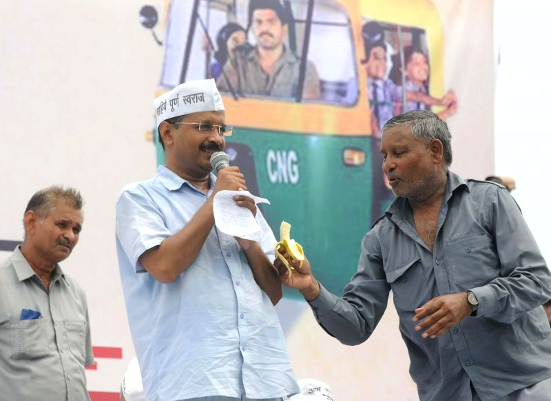 Aam Aadmi Party (AAP) leaders Arvind Kejriwal and Manish Sisodia during a rally organised by auto-drivers at Ramlila Maidan in New Delhi on July 31, 2014.