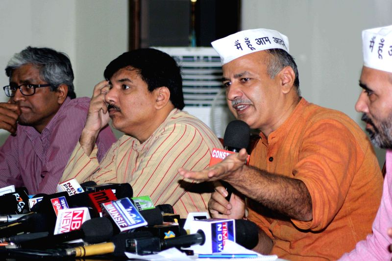 Aam Aadmi Party (AAP) leaders Ashutosh, Sanjay Singh, Manish Sisodia and Gopal Rai during a press conference in New Delhi on July 19, 2014. - Sanjay Singh and Gopal Rai