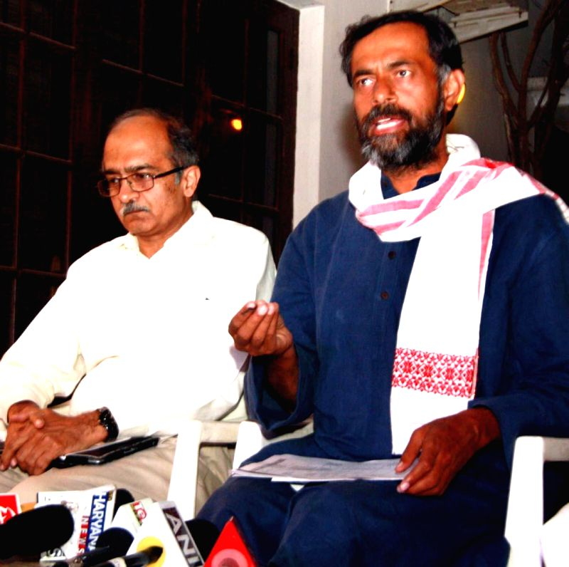 Aam Aadmi Party (AAP) leaders Yogendra Yadav and Prashant Bhushan during a press conference in Gurgaon on April 10, 2014. - Yogendra Yadav