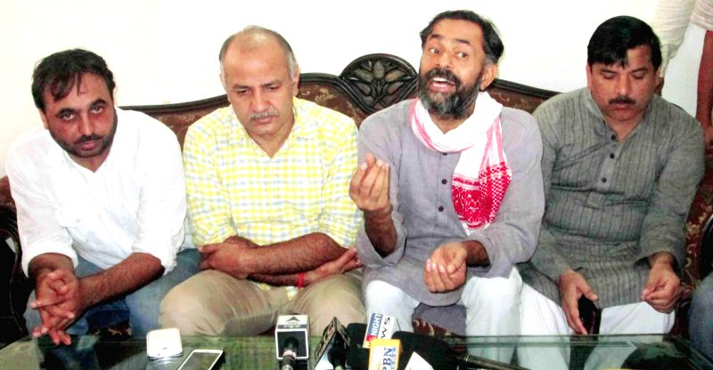 Aam Aadmi Party AAP MP Bhagwant Mann with other party leaders Manish Sisodia, Yogendra Yadav and Sanjay Singh during the party workers meeting in Sangrur on July 25, 2014. - Yogendra Yadav and Sanjay Singh