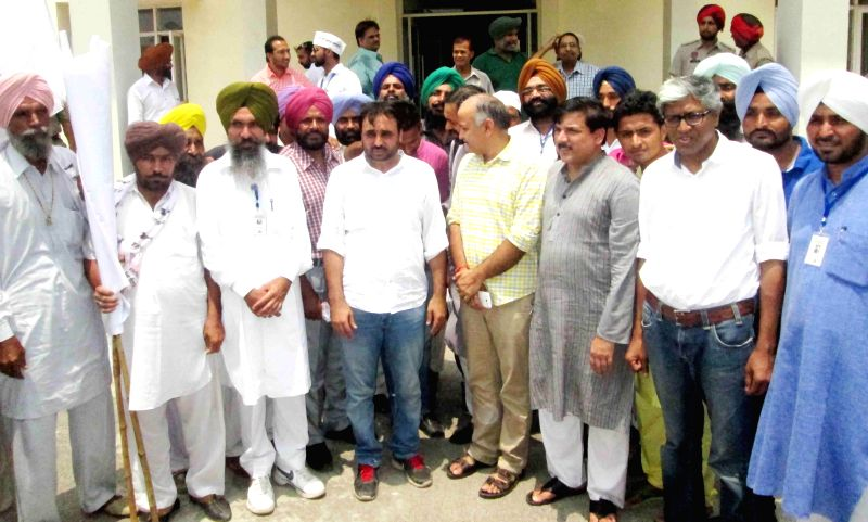 Aam Aadmi Party AAP MP Bhagwant Mann with other party leaders Manish Sisodia, Sanjay Singh and Ashutosh during the party workers meeting in Sangrur on July 25, 2014. - Sanjay Singh
