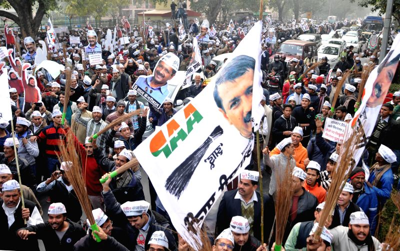 Aam Aadmi Party (AAP) supporters participate in Arvind Kejriwal's roadshow in New Delhi, on Jan 20, 2015. - Arvind Kejriwal