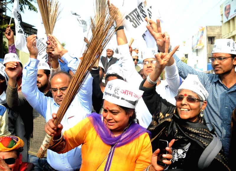 Aam Aadmi Party (AAP) workers celebrate party's victory in the recently concluded Delhi Assembly Polls in Bhopal, on Feb 10, 2015.