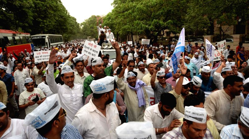 Aam Aadmi Party (AAP) workers participate in a protest march towards Raj Niwas in New Delhi, on June 13, 2018.