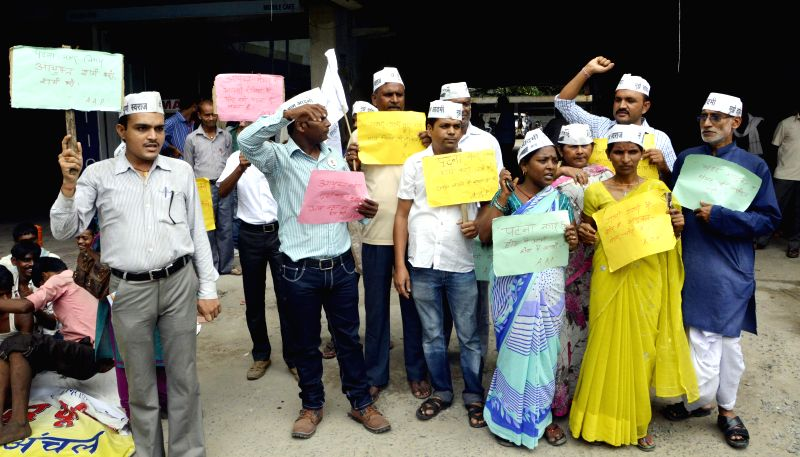 Aam Aadmi Party (AAP) workers stage a demonstration in front of Patna Municipal Corporation on Aug 26, 2014.