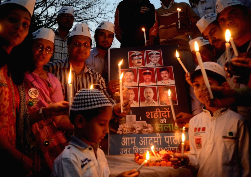 Aam Aadmi Party workers hold a candlelight vigil to pay tribute to 26/11 Mumbai attacks victim in Bhopal, on Nov 26, 2015.
