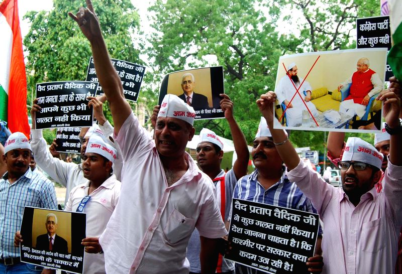 Aam Aadmi Sena activists stage a demonstration in support of journalist Ved Prakash Vaidik who is in news for meeting 26/11 mastermind Hafiz Saeed during his recent Pakistan visit, in New Delhi on ...