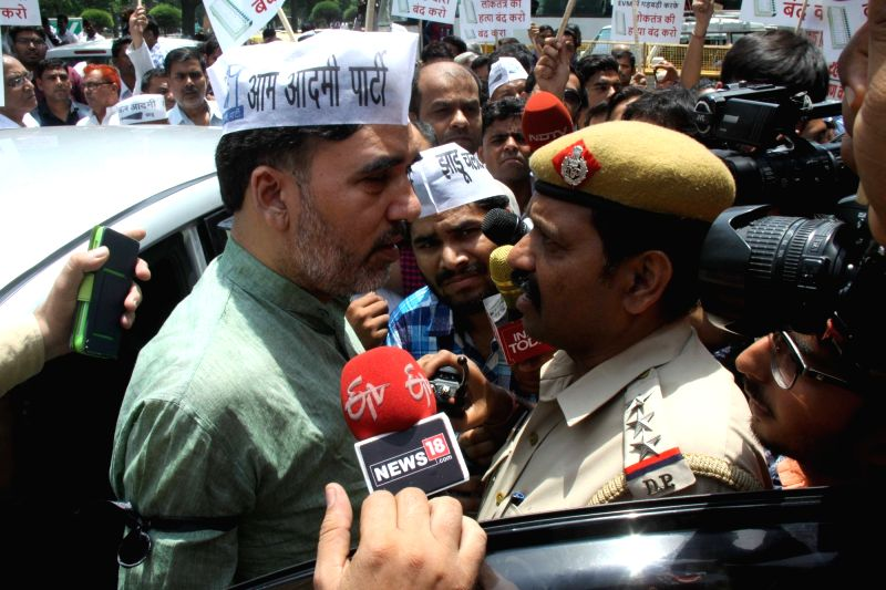 Aam Admi Party leader Gopal Rai with party workers protest  outside Election Commission headquarters against alleged EVM tampering in New Delhi on May 11, 2017. - Gopal Rai