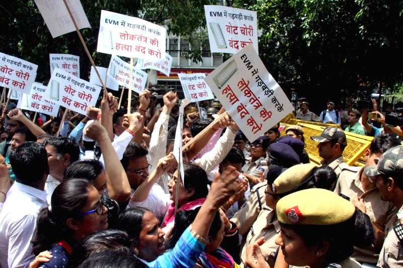 Aam Admi Party workers protest outside Election Commission headquarters against alleged EVM tampering in New Delhi on May 11, 2017.