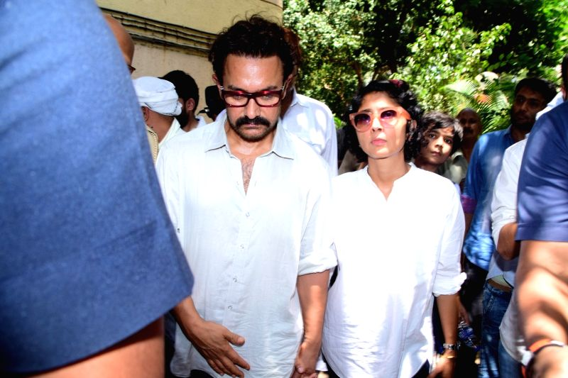Aamir Khan along with wife and filmmaker Kiran Rao during the funeral of actress Reema Lagoo in Mumbai, on May 18, 2017. Reema died following a cardiac arrest at the Kokilaben Dhirubhai ... - Reema Lagoo, Aamir Khan and Kiran Rao